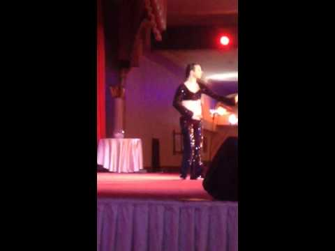 Male belly dancer end of act