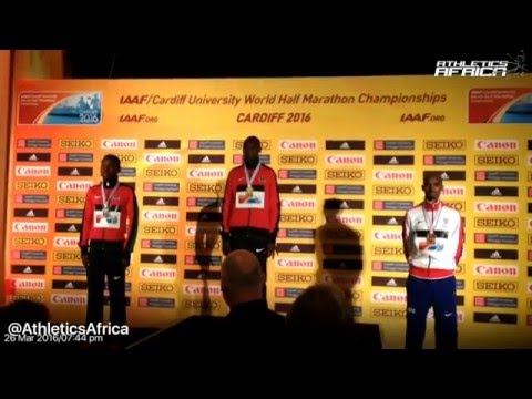 Men's race Podium: Geoffrey Kamworor & Mo Farah receives their medals in Cardiff 2016