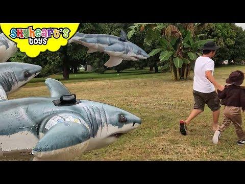 FLYING SHARKS vs Toddler | Skyheart battles an army of sharks for kids toys pool