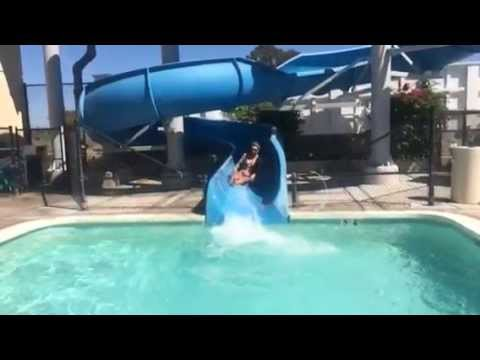 labor-day-woman-takes-water-slide-into-pool-slow-motion.html