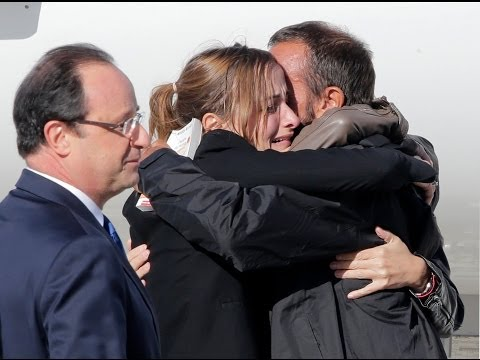 Freed French hostages arrive home after 3 years - no comment