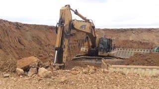 Caterpillar 365C L Excavator   Loading Mercedes Actros 4144