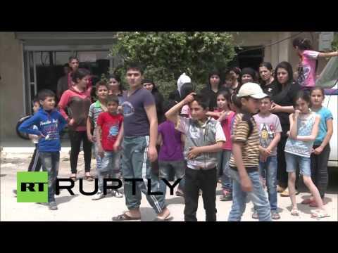 Syria: Russian troops deliver humanitarian aid to Ayn al-Dananir