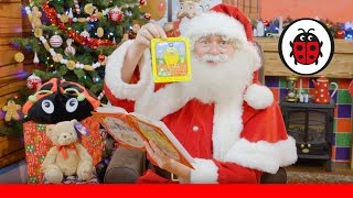 Santa reads The Jolly Christmas Postman from Hamleys