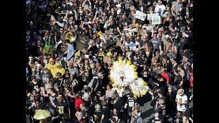 Saints fans parade through the French Quarter singing 'We got robbed'