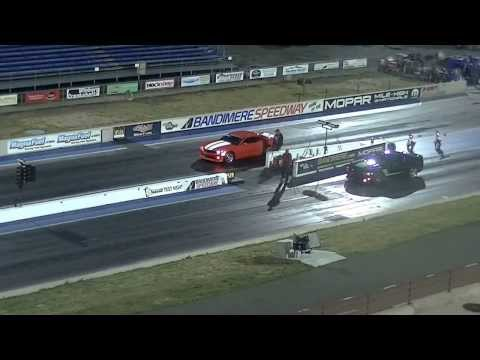 2012 Ford Roush Mustang Stage 3 vs Chevy SS Camaro with Magnacharger at Bandimere