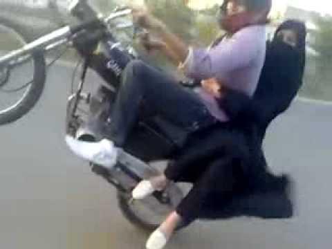 Pakistani Girl and Boy enjoying Bike Wheel y    Sialkot