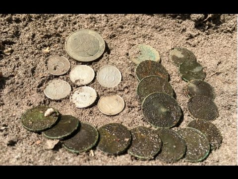 Found a lot of coins while metaldetecting an old swimming pool