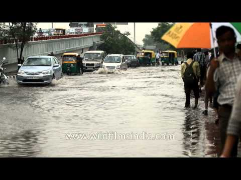 Heavy rains flooding the roads of New Delhi