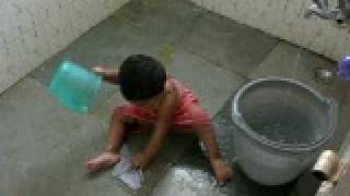 world's most cute baby washing her own clothes.AVI