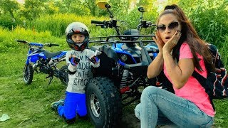 Funny Den ride on Cross Bike and help Mom fix broken down Quad Bike