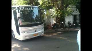 Dhoni on Yamaha RX, Raina in Porsche, and rest of the CSK team in benz bus, near Alwarpet,Chennai