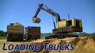 Bucyrus Erie 20-H Excavator Loading the International and GMC Dump Trucks