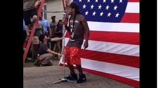 Mega-Millionaire Baboonal White Racial Envy-Monkey Nigger Lil Wayne Stomps On USA Flag