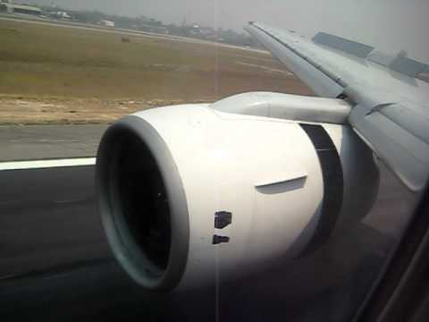 Boeing 777 Landing - Thai Airways full view trust reverse Rolls Royce Trent 800 jet engines