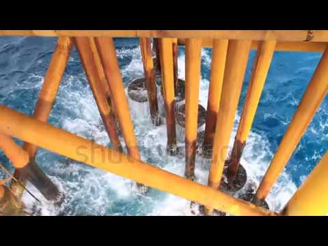 waves hit oil and gas producing slots at offshore platform oil and gas industry 4