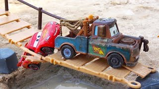 Lightning Mcqueen falls in the water. Disney Cars Mater toys play