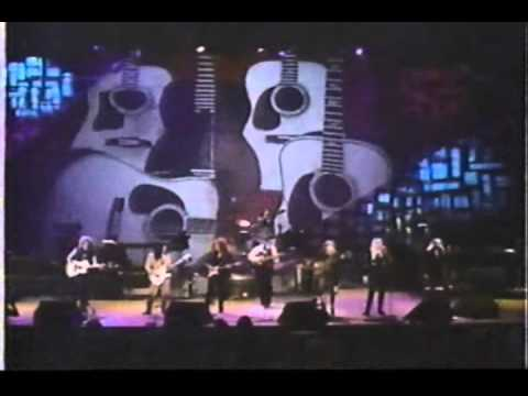 lang, RAITT, WEYMOUTH and HARRIS, and PETERSON performing PRETTY WOMAN.wmv