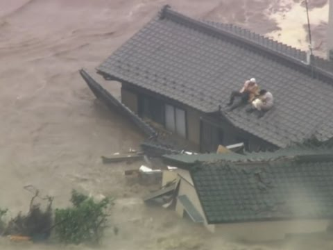 Raw: Floods in Japan Strand People on Rooftops