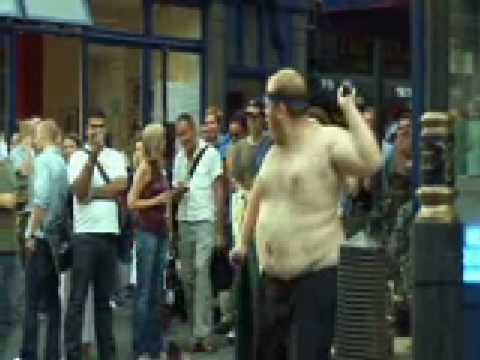 Funny fat man dancing in street (Pendulum-Slam)