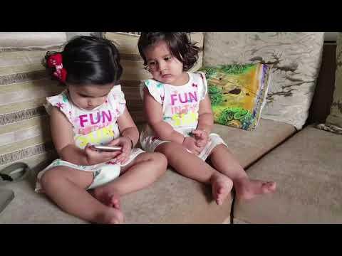 Bella and  Vienna watching videos