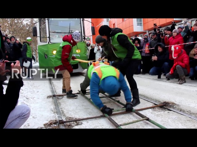Russia: Woman leaves crowds in awe by pulling two trams filled with passengers