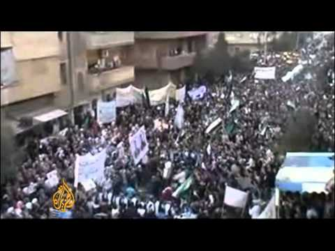 Thousands march in Syrian cities
