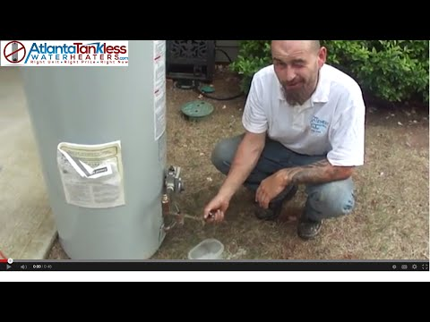 Tankless Water Heater Reviews:  Atlanta Plumber Shows Hot Water Heater Debris Build Up Inside Tank