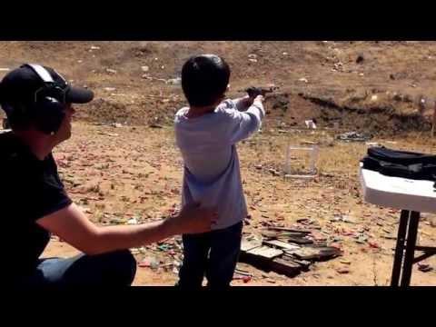Logan shooting long range pistol shots.