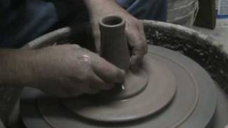 THROWING A WATERING CAN ON THE WHEEL PART 1.wmv