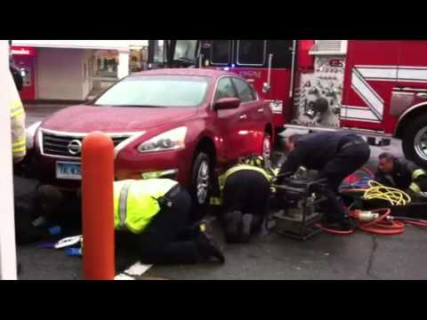 Firefighters rescue man pinned under car