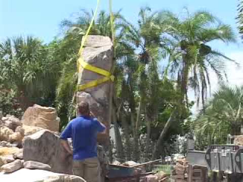 Building a natural stone grotto water feature for a lagoon - How to build a swimming pool waterfall ...