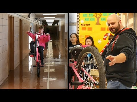 CHRIS AND KONRAD VISIT IS.7 AND TEACH KIDS ABOUT BIKES