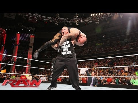 Brock Lesnar F-5s The Undertaker: Raw, March 31, 2014 video