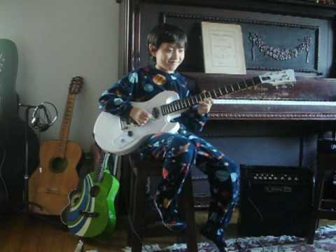 Cute 8 year-old Kid plays Hotel California guitar solo