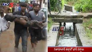 నాలాలో కొట్టుకుపోయిన బాలుడు! | Heavy Rains in Nizamabad