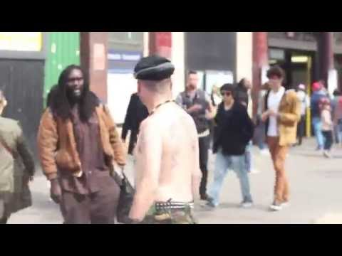 racist man tries to fight two rastamen
