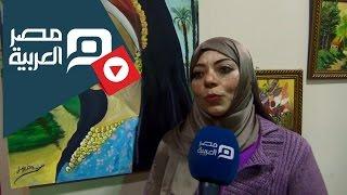 مصر العربية | اللوحات الزيتية تزين القاعة الرئيسية بمعرض الكتاب