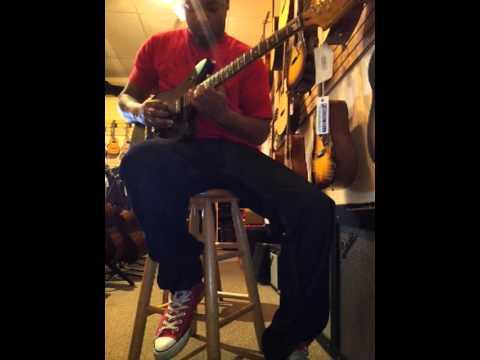 darrien williams testing guitar