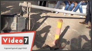 سقوط أحد أعمدة الإنارة على سيارة معيد بكلية آداب القاهرة