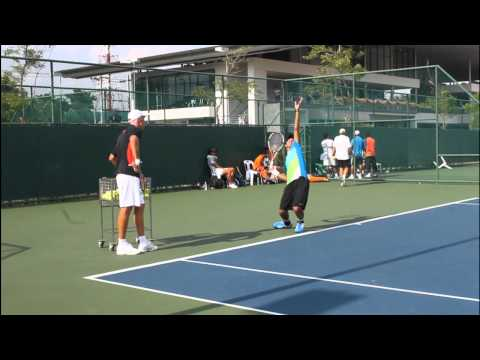 BUILT - SIRAWIT YUMUANG in serve-practice with TODD MARTIN on 19 May 2011 at LTAT, Thailand