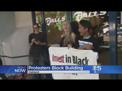 Oakland Protesters Chain Themselves To Police Officers Association Building