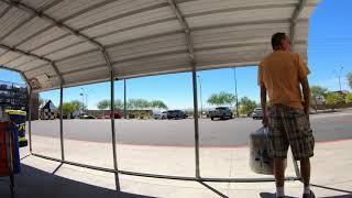 Moving Valley Metro Rural Route Bus Stop to Auto Care Center, Walmart, Buckeye, Arizona, GX057273