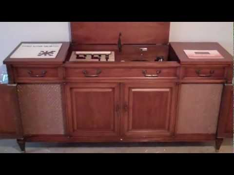 1965 Fisher Ambassador Console Stereo. Playing Stereo Unlimited Action Series. Enjoy!