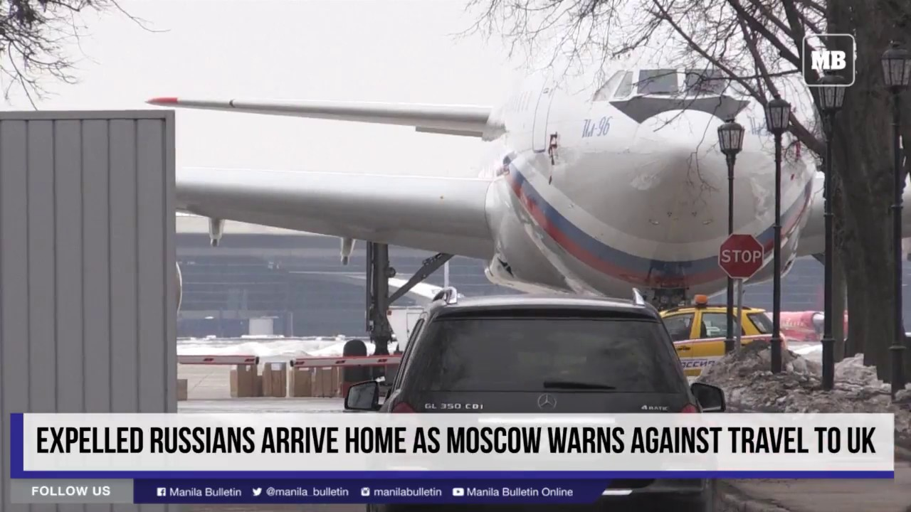 Expelled Russians arrive home as Moscow warns against travel to UK