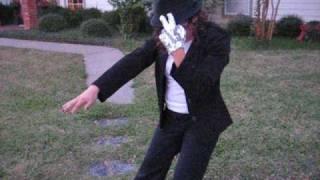kid trying to dance like Michael Jackson