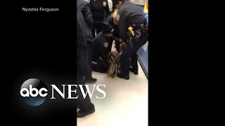 Video shows officers in tug-of-war with mother over baby