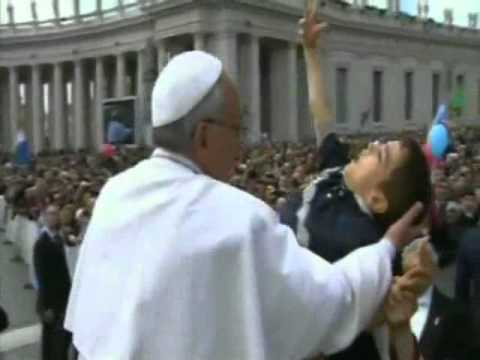 MOVING MOMENT: Pope Francis blesses disabled child.