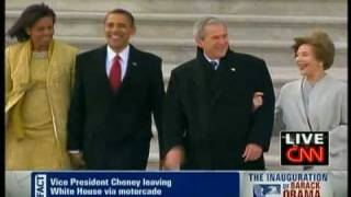 Barack Obama walks George W. Bush to