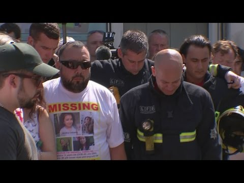 Grenfell Tower fire: Firefighters tear up during minute's silence